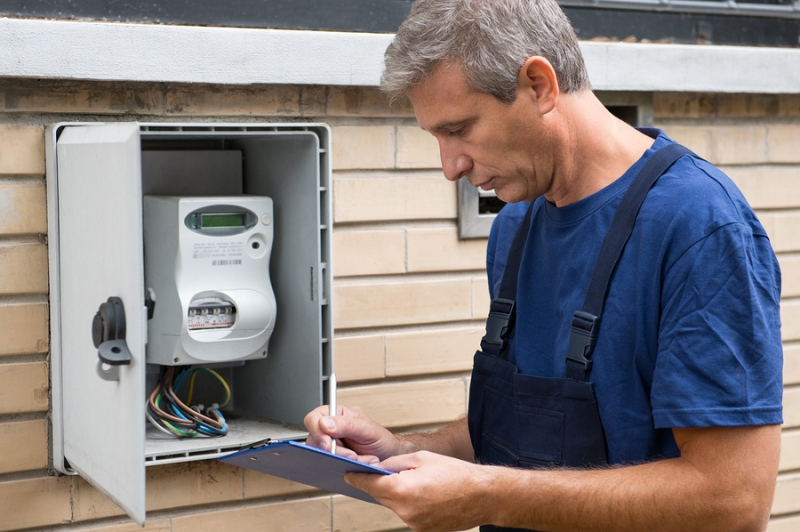 An electrician conducting an electrical safety inspection